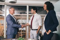 Shaking hands to a successful merger Stock Photos