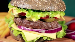 Burgers on the black bun and bun with sesame seeds Stock Footage