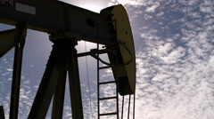 Oil Pump Close up Fracking back lit by the sun Stock Footage