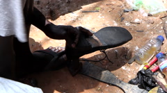Shoemaker in street city of Bisseau - Guinea Africa Stock Footage