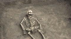 Excavation Of A Female Skeleton Stock Footage