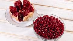 Splintered rotating fresh pomegranate Stock Footage