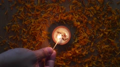 Lighting a Traditional clay diya lamps lit during diwali celebration Stock Footage