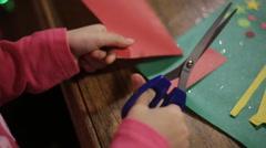 Girl learning to cut with scissors. preschool development of creativity Stock Footage