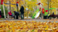 Beautiful nature scene of Autumn Leaves and hurrying people Stock Footage