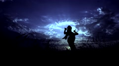 Moon Blue Color. Silhouette Against Sunset of One Young Graceful Girl Stock Footage