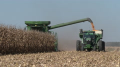 Corn harvest underway with combine and receiving trailer, 4K. Stock Footage