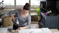 Woman assembles a piece of furniture in kit Stock Footage