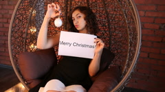 """Young girl shows the inscription: """"Merry Christmas Stock Footage"""
