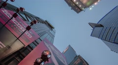 Hyperlapse walk on 42nd street of Manhattan skyscrapers on blue sky background Stock Footage