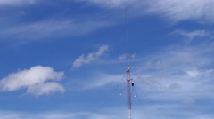Home based single spike antenna tower light clouds day time lapse Stock Footage