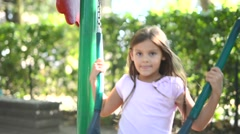Child having fun on a seesaw Stock Footage