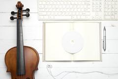 Keyboard computer  notebook dvd disc and violin Kuvituskuvat