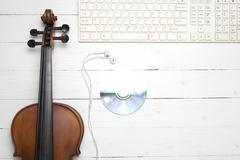 Keyboard computer with dvd disc and violin Kuvituskuvat