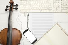 Violin with keyboard computer music paper note notebook and smart phone Kuvituskuvat