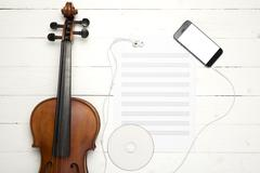 Violin with  music paper note dvd disc and smart phone Kuvituskuvat