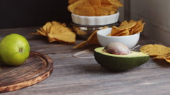 Set of products necessary to cook guacamole sauce and nachos chips Stock Footage