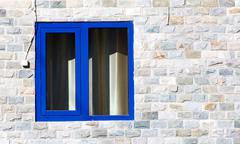 Window in a brick building of granite Stock Photos