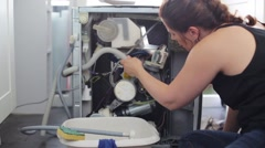Woman repairs the leak Stock Footage