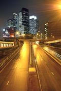 Urban landscape at night and through the city traffic Stock Photos