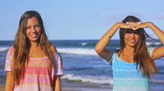 Twin Sisters At The Beach Harsh Sunny Day in Slow Motion Stock Footage