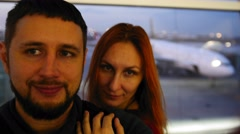 Young european couple Man and Woman make Selfie at Departure Lounge at the Stock Footage