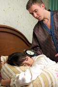 Man trying to wake his wife Stock Photos