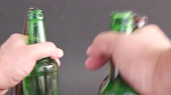 Close up of beer bottles in a man's hands Stock Footage
