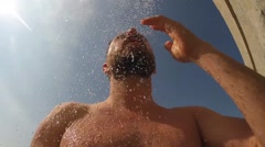 Man takes a shower outside Stock Footage
