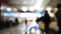 Crowd at moving staircase at airport - blurred abstract background Stock Footage