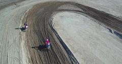 Two MotoCross riders on the track making a jump, aerial view from a drone Stock Footage