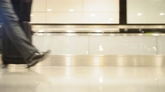People walking on moving staircase with luggage in the international airport Stock Footage