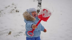 Child catches snowflakes mouth in slowmotion Stock Footage