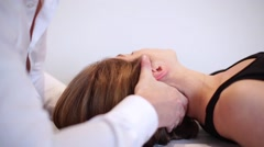 Osteopath treats a patient Stock Footage