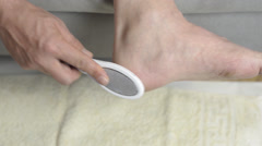 Remove the foot care cornea Stock Footage