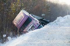 Truck in winter road accident Stock Photos