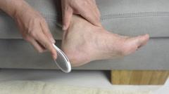 Remove the foot care cornea Stock Footage