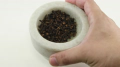 Close-up of Hands with a marble mortar of whole clove spices Stock Footage