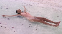 Beautiful girl floating in the Dead Sea. Stock Footage