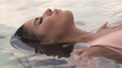 Beautiful tourist floating in the Dead Sea Stock Footage