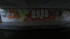 Graffiti under a bridge. Stock Footage