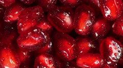 Rotating fresh pomegranate seeds for food Stock Footage