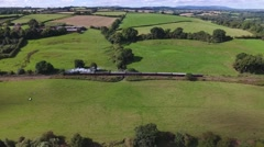 Beautiful aerial tracking shot of a steam train in the Severn Valley. Stock Footage