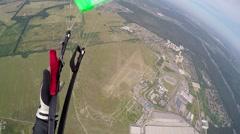 Skidiver parachuting down pov Stock Footage