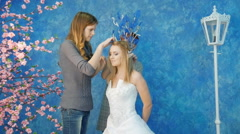 Make-up artist and stylist make the image of the elven princess Stock Footage