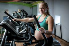 Pregnant woman exercising on treadmill Kuvituskuvat