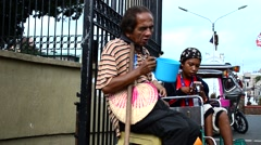 Disabled Beggars at Church yard Gate Portal Arkistovideo