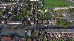 Aerial view of a housing estate and school with children playing. Stock Footage