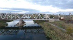 Nice view from the height on the railroad bridge, shooting a drone flying over Stock Footage