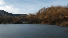 Panorama of a beautiful half frozen lake on sunset. High angle 4K pan shot Stock Footage
